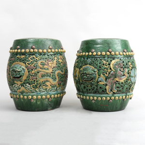 Pair of Chinese Green, Aubergine and Yellow Glazed Pottery Garden Seats with Dragons and Cloud Bands