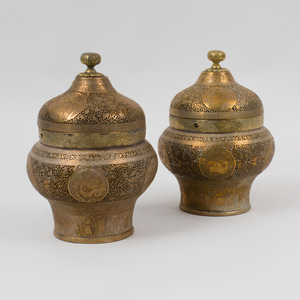 Pair of Qajar Pierced Brass Urn Form Jars and Covers