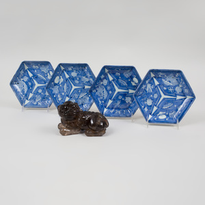 Group of Four Chinese Hexagonal Blue and White Porcelain Plates and a Smokey Quartz Figure of a Buddhistic Lion