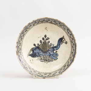 Persian Glazed Pottery Dish Decorated with a Camel