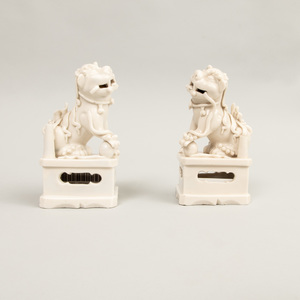 Pair of Chinese Blanc de Chine Porcelain Figures of Buddhistic Lions
