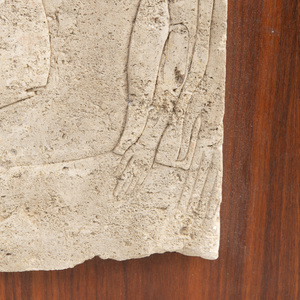 Egyptian Limestone Relief Fragment: A Young King Being Suckled by the Goddess Isis