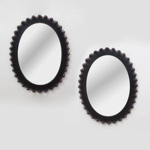 Pair of Modern Ebonized Metal Oval Mirrors