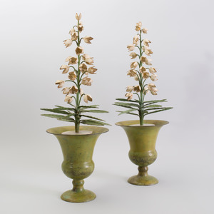 Pair of French Tôle Peinte Urns Containing Tôle Peinte Floral Plants, Fitted into Marble Urns