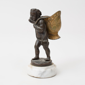 Bronze Putto Carrying a Gilt-Bronze Helmet