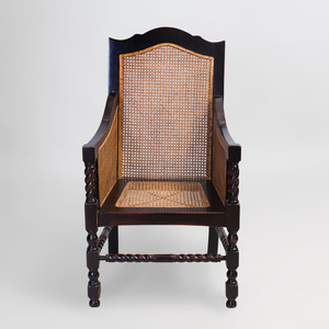 Continental Ebonized and Caned Armchair