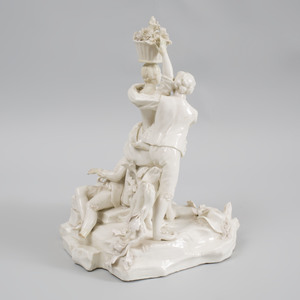 French Porcelain White Glazed Figure Group of a Courting Couple with Spurned Suitor