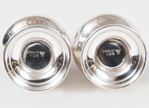 Pair of Small Silver Casters and Covers