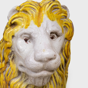 Pair of Continental Glazed Faience Lions, Possibly French