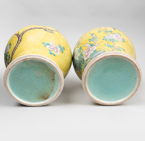Pair of Chinese Yellow Ground Famille Rose Porcelain Baluster Form Jars and Covers