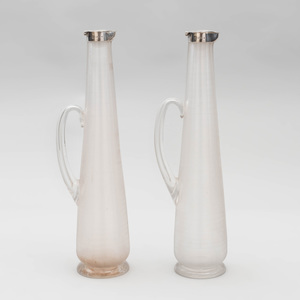 Pair of Victorian Silver-Mounted Ribbed Glass Claret Jugs, After a Design by Christopher Dresser