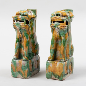 Pair of Chinese Green and Yellow Glazed Buddhistic Lion Porcelain Candleholders