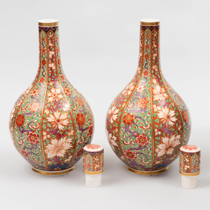 Pair of English Polychrome Decorated Porcelain Bottle Form Vases and Stoppers
