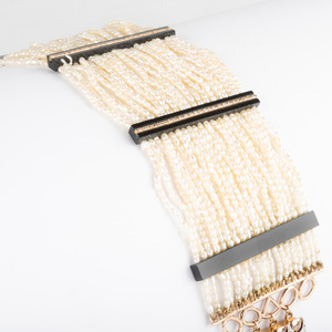 14K Gold, Seed Pearl, Diamond, and Black Onyx Bracelet