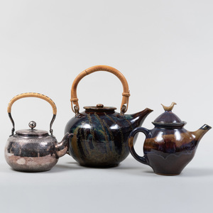 Two Studio Pottery Glazed Earthenware Teapots and a Japanese Silver Metal Teapot