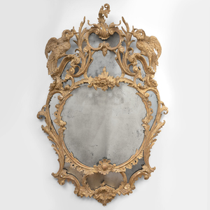 An Extraordinarily Fine and Unusual George III Cartouche-Shaped Giltwood Mirror, in the Chippendale Manner