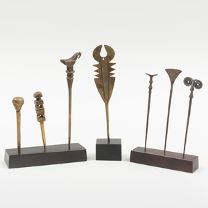 Group of Seven African Metal Pins