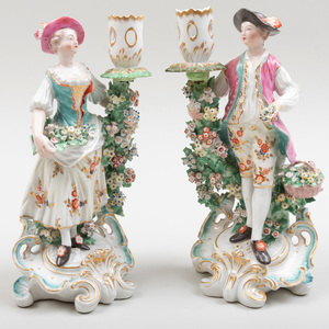 Pair of Chelsea-Derby Porcelain Figural Candlesticks of a Gardener and Companion
