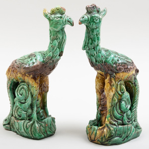 Pair of Chinese Green Ochre and Aubergine Glazed Earthenware Models of Phoenix