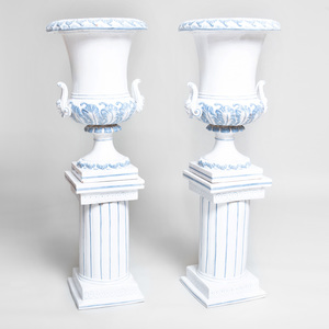 Pair of Continental Tin Glazed Terracotta Urns on Pedestals