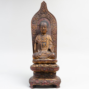 Japanese Gilt-Lacquered Wood figure of a Lohan on Stand