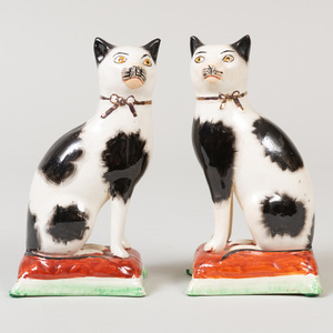Pair of Staffordshire Pottery Models of Seated Cats