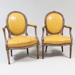 Louis XV/XVI Painted Fauteuil en Cabriolet and a Louis XVI Painted Fauteuil en Cabriolet