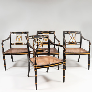 Set of Four Regency Ebonized, Parcel-Gilt and Caned Armchairs