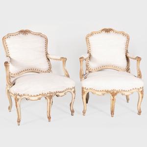 Pair of Louis XV Style Cream Painted and Parcel-Gilt Fauteuils à la Reine