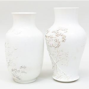 Two Chinese White Glazed Relief Decorated Porcelain Vases