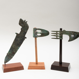Luristan Bronze Axe Blade,  a Luristan Bronze Slotted Axe, and a Chinese Western Zhou Dynasty Dagger with Decorated Handle