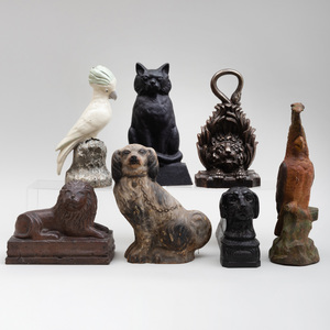 Group of Five English and American Cast Iron Doorstops, a Dog Form Boot Scraper, and a Camel Form Shoe Shine Stand
