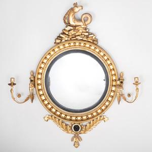 Fine Regency Giltwood and Ebonized Four Light Girandole Mirror