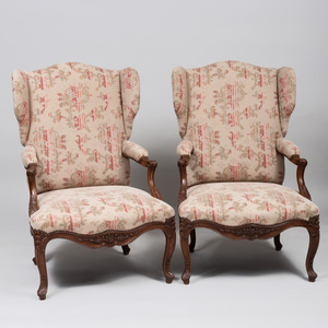 Pair of Règence Style Carved Beechwood Wing Chairs