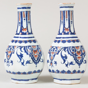 Pair of Continental Faience Faceted Bottle Vases