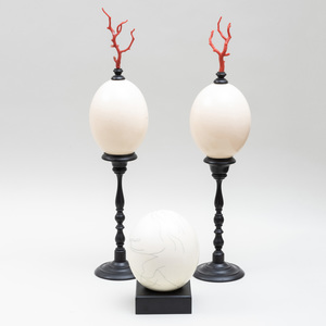 Pair of Ostrich Eggs on Ebonized Mounts and Another Ostrich Egg