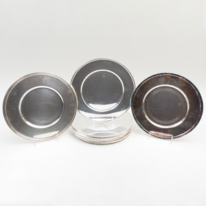 Set of Eight Ercuis Silver Plate Chargers and Two Christofle Silver Plate Chargers