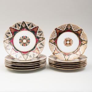 Set of Twelve Austria Gilt Decorated Porcelain Plates in the 'Alhambra' Pattern
