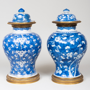 Near Pair of Gilt-Metal-Mounted Chinese Blue and White Porcelain Jars and Covers