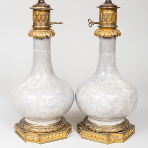 Pair of Louis XVI Style Ormolu-Mounted Chinese White Crackle Glazed Porcelain Bottle Vases Mounted as Lamps