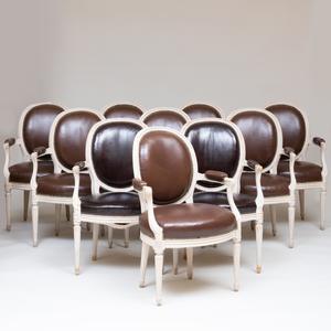 Assembled Set of Ten Louis XVI Style Cream Painted Fauteuils en Cabriolet