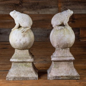 Pair of Composition Garden Orbs Surmounted by Frogs