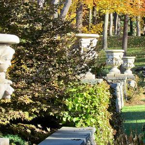 Set of Four Louis XIV Style Cast Stone Garden Urns