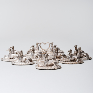 Twelve Silver Whippet Form Placecard Holders and a Menu Holder