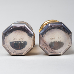 Two Sets of Eight Cartier Silver Casters