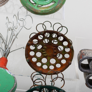 A Group of Eighteen Wire, Cast Iron and Metal Flower Frogs